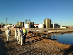 Members of the project tour the facilities of PURAL in Almazán